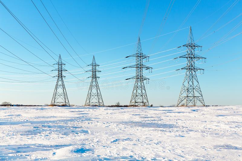 Electrical pylons in the snow stock photos