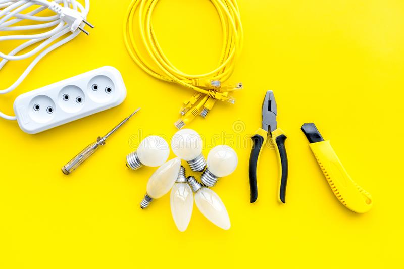 Electrical Accessories At Home Bulbs Socket Outlet Cabel On Yellow Background Top View Copy Space Stock Image Image Of Engineer Occupation 114299917