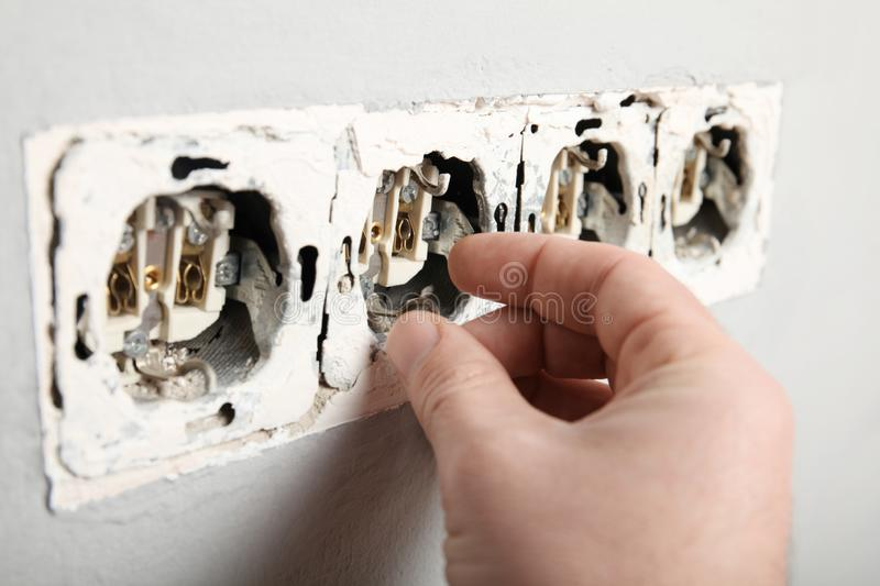 Electrical short circuit, dangerous use of electricity. Damaged socket in the wall stock photography