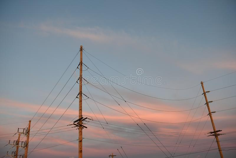 Electrical substation architecture and high voltage power supply lines. Electrical utility poles and high voltage power lines at sunset in Wyoming, USA royalty free stock image