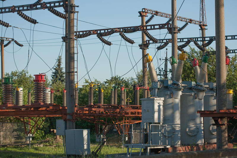 Electrical substation infrastructure with close up on electrical circuit breakers. royalty free stock photography