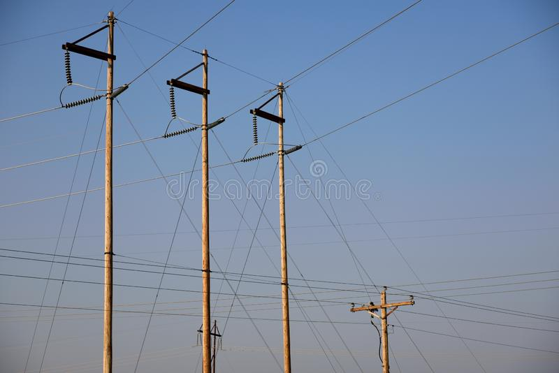 Electrical substation utility poles and overhead high voltage power supply lines in Wyoming. USA stock photos