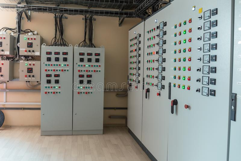 Electrical switch gear cabinets, control panels in factory.  stock images