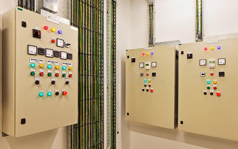 Electrical switch gear and circuit breakers that control heat, heat recovery, air conditioning, light and electrical power supply. Mechanical electrical control royalty free stock photos