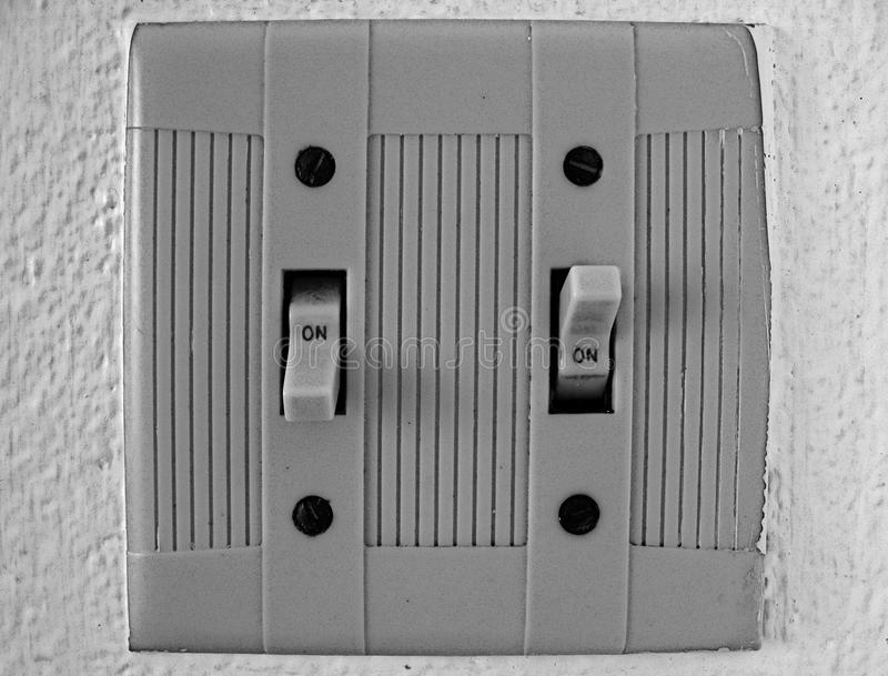 Electrical switches on-on. Abstract, electrical switches on-on on a white wall stock images