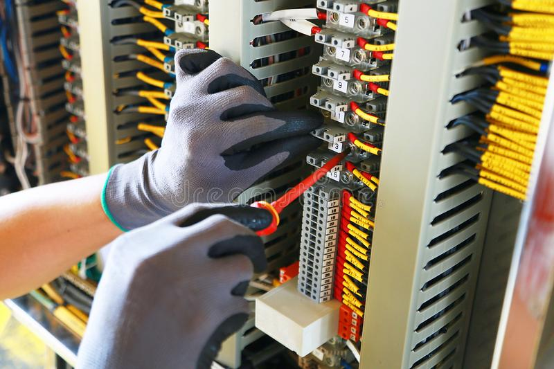 Electrical terminal in junction box and service by technician. Electrical device install in control panel for support program. And control function by PLC stock photography