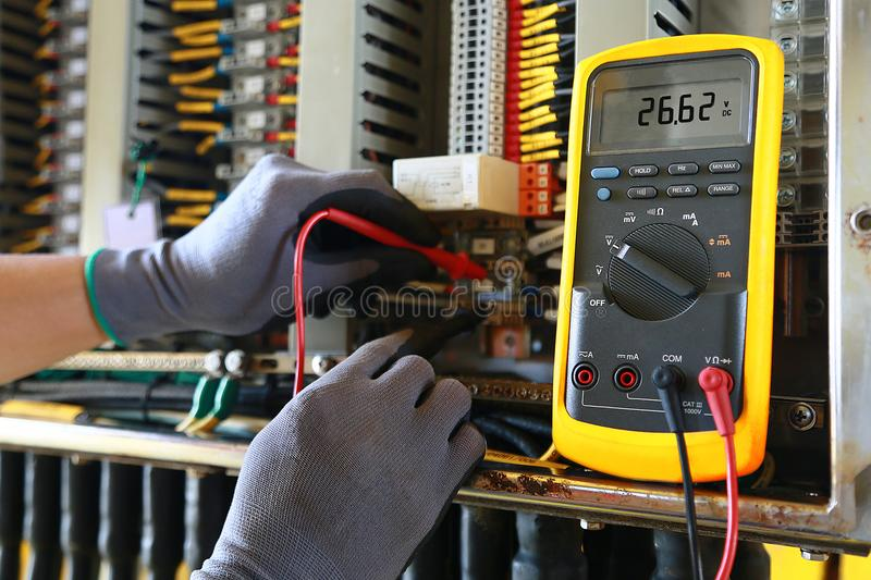 Electrical terminal in junction box and service by technician. Electrical device install in control panel for support program. And control function by PLC royalty free stock photo