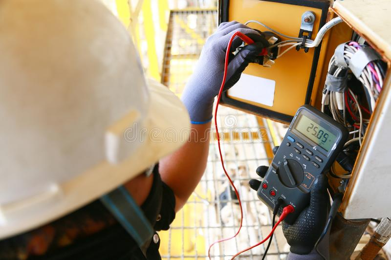 Electrical terminal in junction box and service by technician. Electrical device install in control panel for support program. And control function by PLC royalty free stock photography