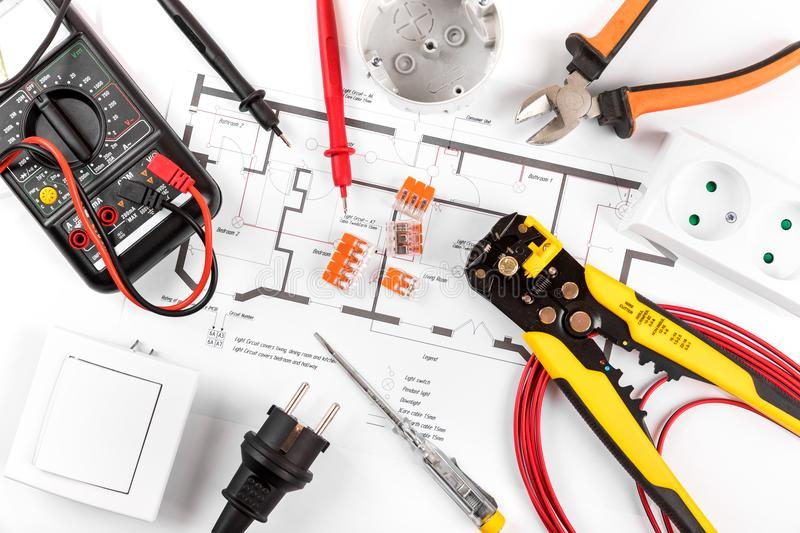Electrical tools and equipment on circuit diagram. Top view royalty free stock images