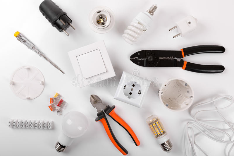 Electrical tools and equipment on white background. Top view stock images