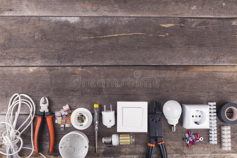 Electrical tools and equipment on wooden background with copy sp. Electrical tools and equipment on brown wooden background with copy space royalty free stock photography