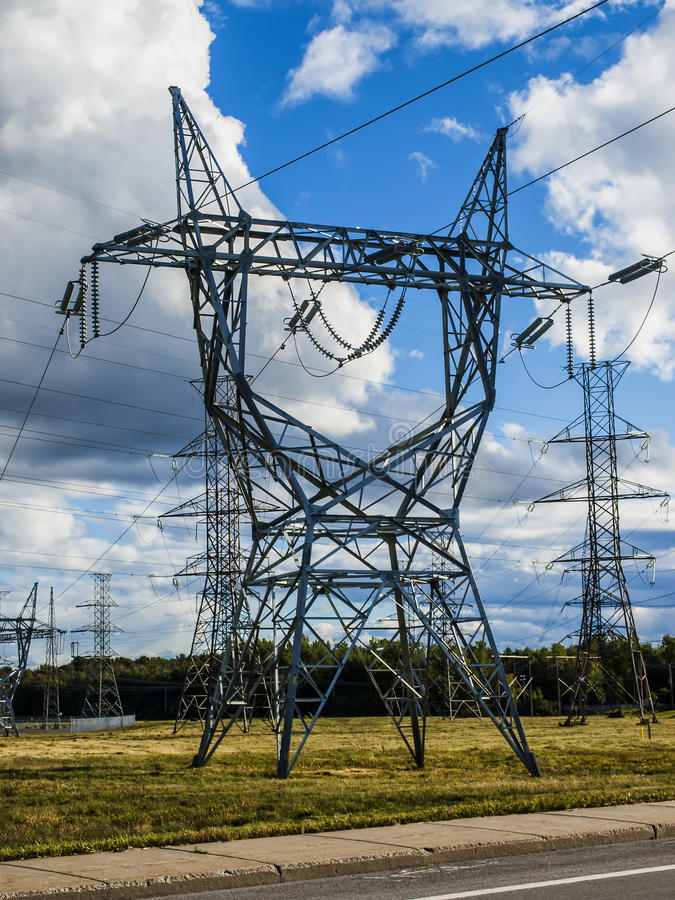 Electrical tower. Near a power plan stock photo