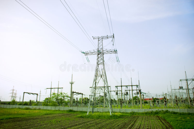 Electrical towers on blue sky background stock images