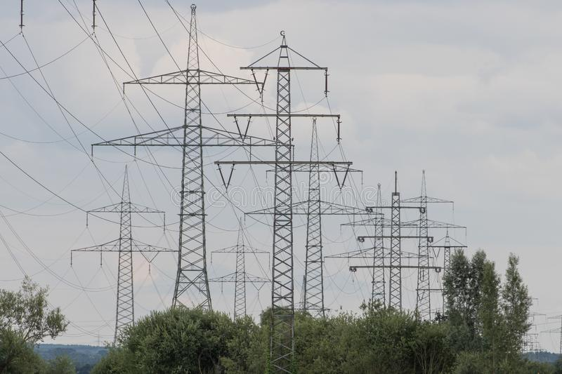 Electrical towers next to schwandorf at sunset. Bavaria stock photography