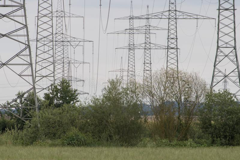 Electrical towers next to schwandorf at sunset. Bavaria royalty free stock photo