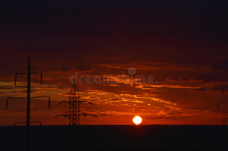 Electrical towers. On the sunrise background royalty free stock photos