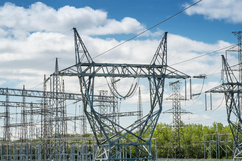 Electrical towers. And wires on a blue sky stock photography