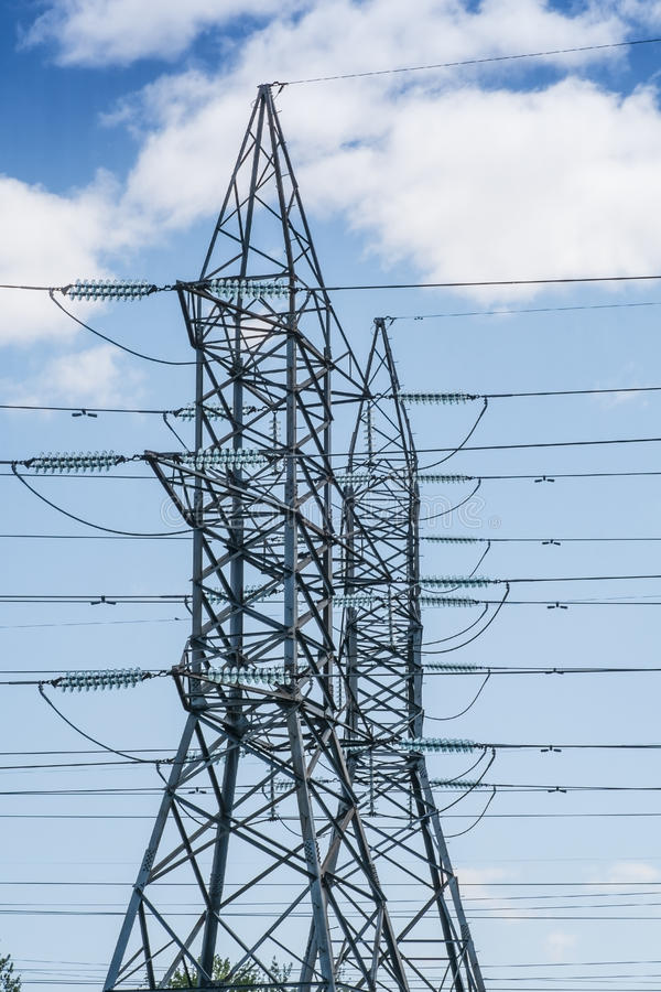 Electrical towers. And wires on a blue sky royalty free stock photography