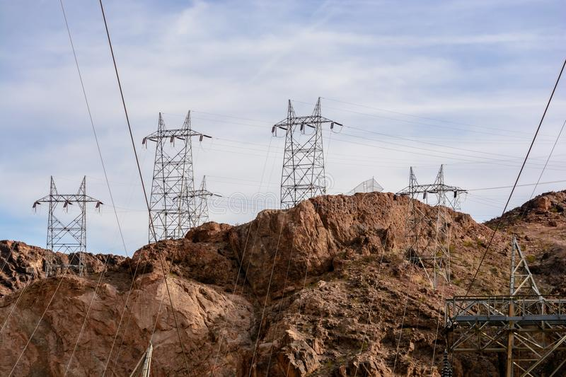 Electrical transmission towers in landscape. A series of electrical transmission towers dot the landscape around Hoover dam royalty free stock image