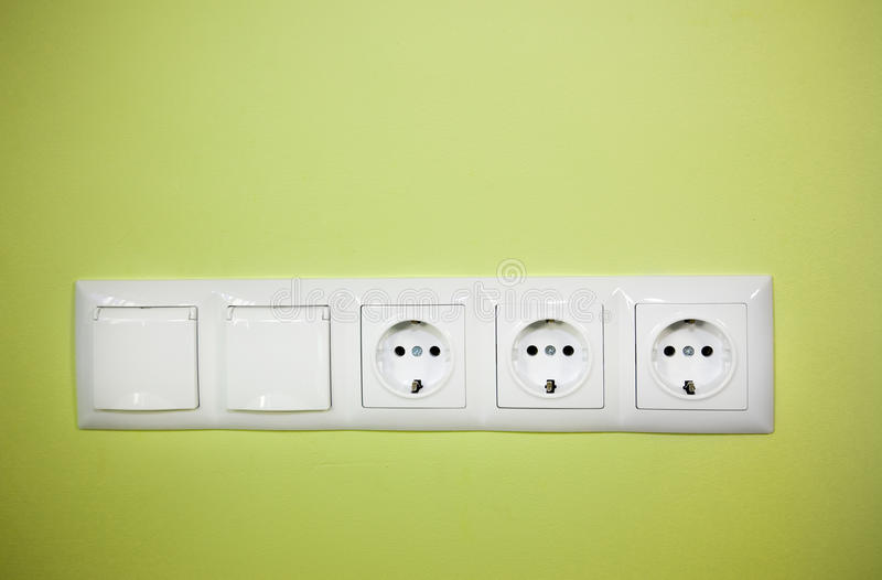 Electrical Wall Outlet / On Green Background Stock Image