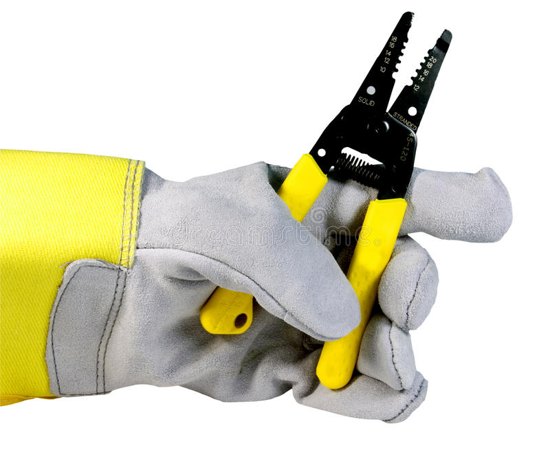 Electrical wire stripper isolated. Wire stripper held by workers glove isolated over white with clipping path at this size stock image