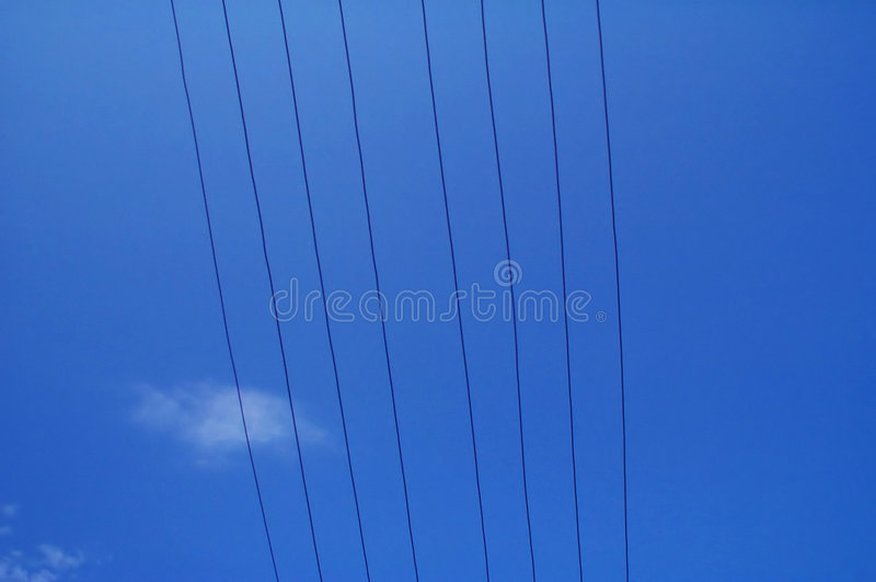 Electrical wires against blue sky stock photos