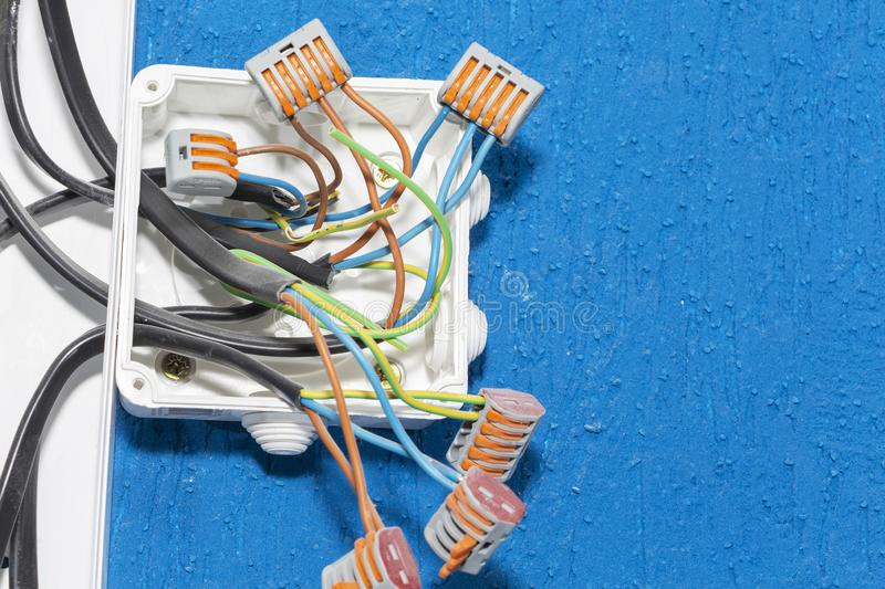 Electrical wires in the box. wires without insulation. security stock photos
