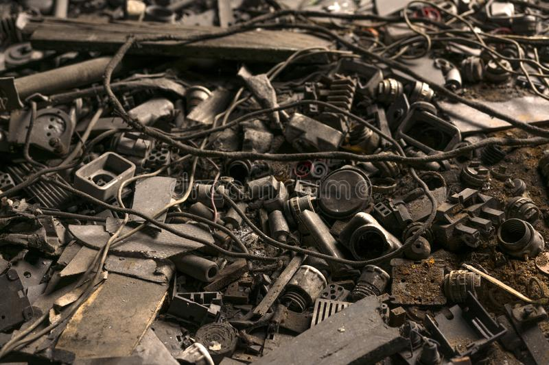 Electrical wires and components are scattered on the floor of the abandoned factory stock image