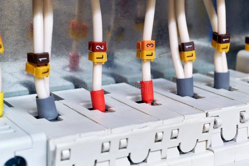 The electrical wires are connected to circuit breakers or fuse holders. The cables have insulated terminals. Reliable and safe. Connection of electrical stock photos