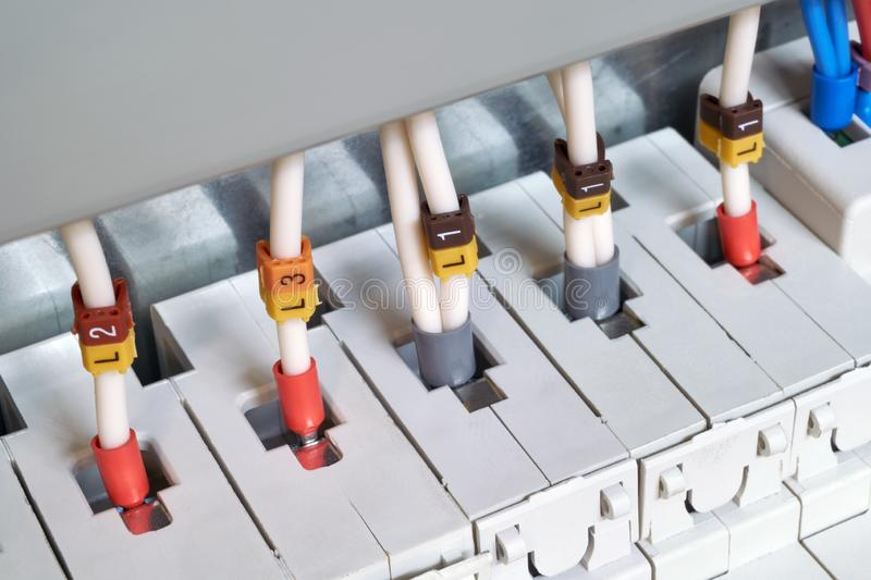 The electrical wires are connected to circuit breakers or fuse holders. The cables have insulated terminals. Reliable and safe connection of electrical royalty free stock images