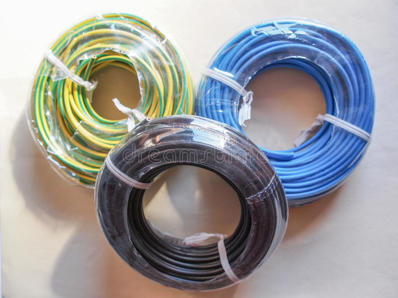 Electrical wires. Electric power distribution cables for live neutral and ground connection stock images