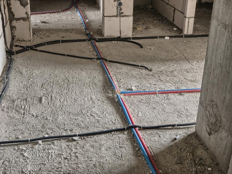 Electrical wiring on the floor. In the building under construction royalty free stock images