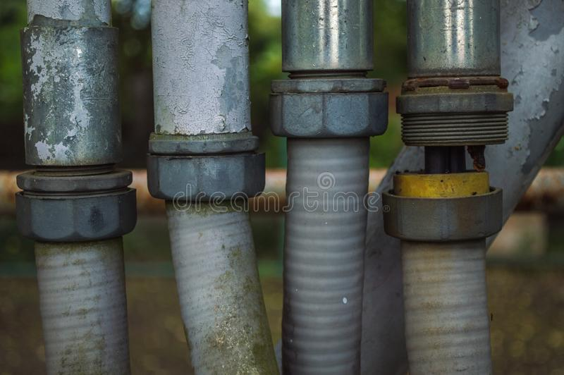 Electrical wiring with grunge metal pipes. royalty free stock photo