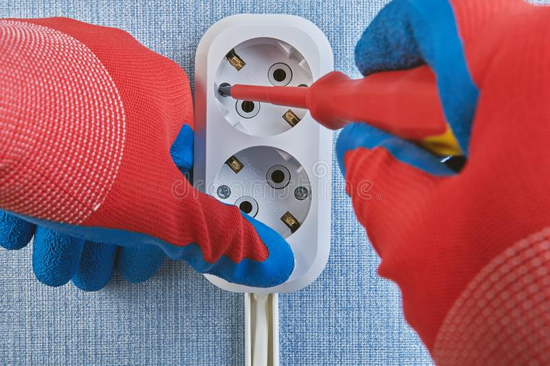 Electrical wiring installation, twisting screws of outlet royalty free stock images
