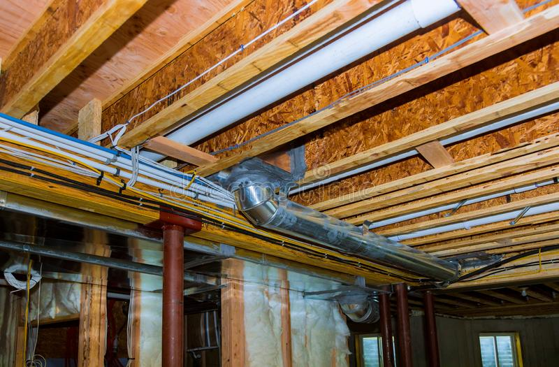 Electrical wiring installed in residential home contruction. In the basement, power, wire, equipment, technology, cable, energy, electricity, connection stock photo
