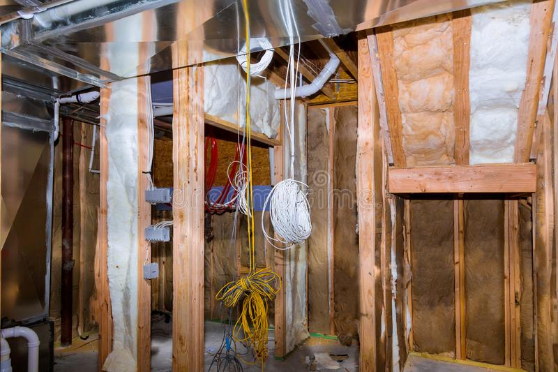 Electrical wiring installed in residential home contruction. In the basement, power, wire, equipment, technology, cable, energy, electricity, connection royalty free stock images