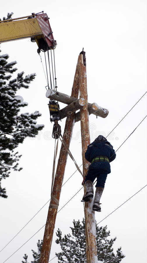 Electrical work at the height of winter royalty free stock photos