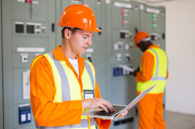 Electrical worker laptop royalty free stock image