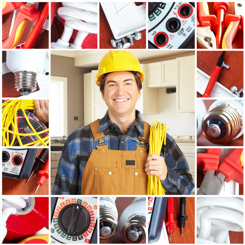 Electrician. Handsome electrician in yellow uniform royalty free stock photos