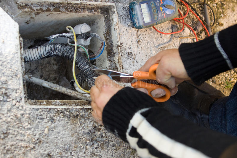 Electrician. At work with its tools on the site royalty free stock photos