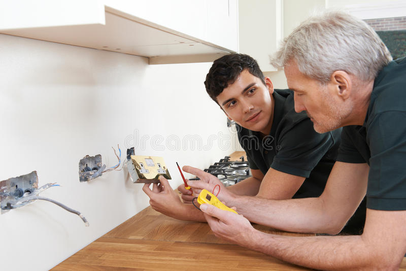 Download Electrician With Apprentice Working In New Home Stock Image - Image of reliable, occupation: 82946655