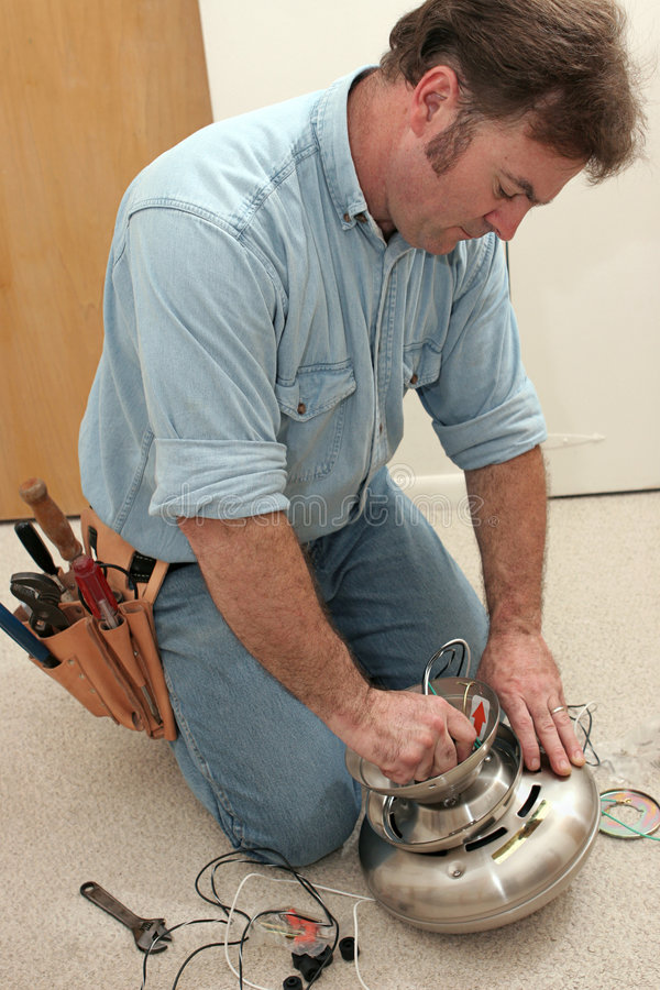Download Electrician Assembles Fan Motor Stock Photo - Image of install, motor: 1173292