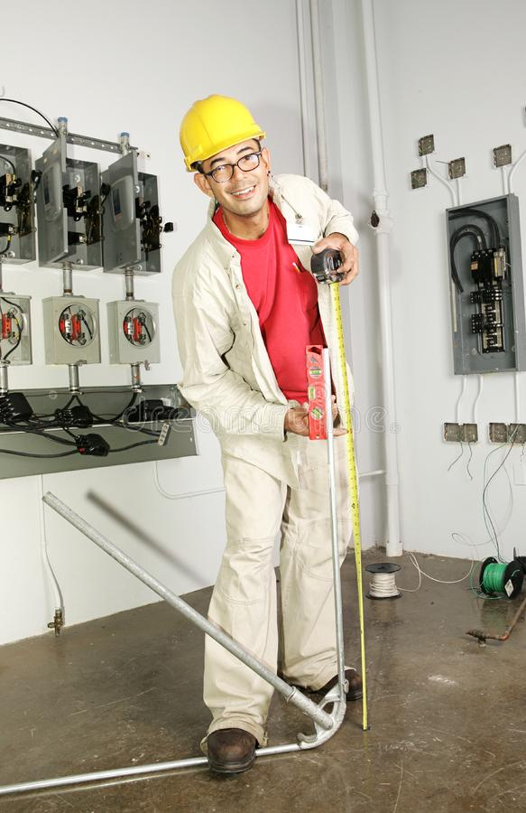 Electrician Bending Pipe royalty free stock photography