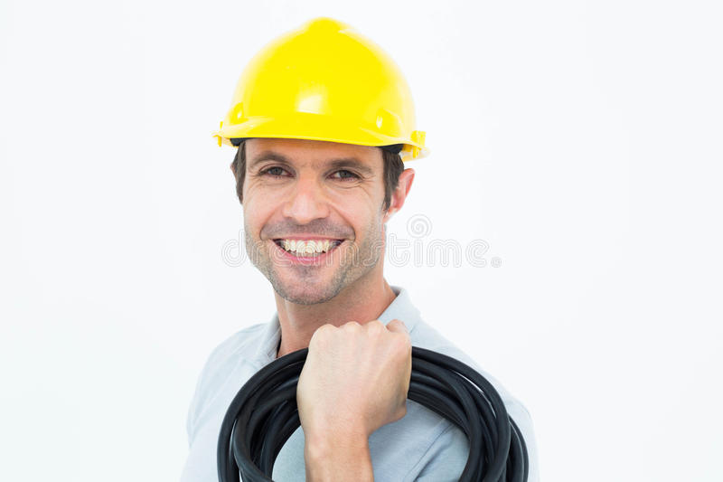 Electrician carrying wires over white background. Portrait of electrician carrying wires over white background royalty free stock photo