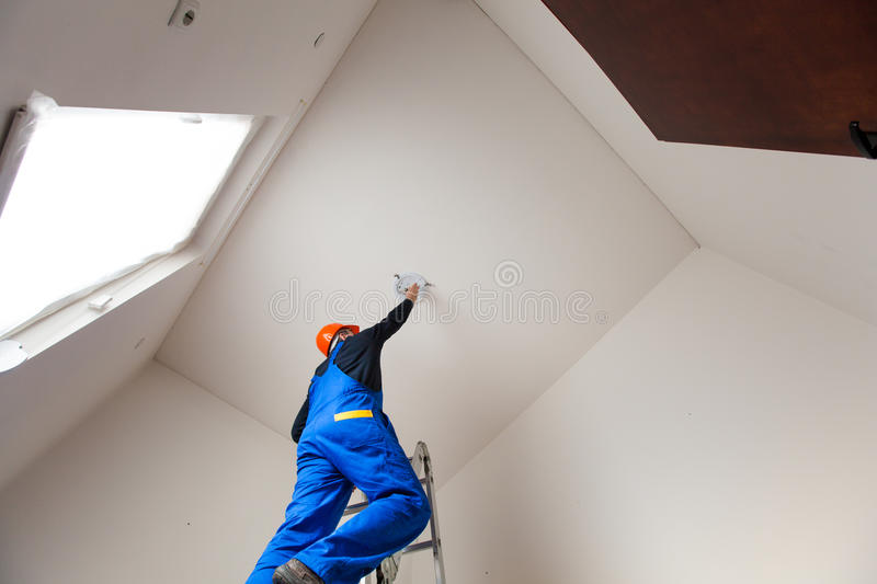 Electrician is Changing a Bulb royalty free stock photos