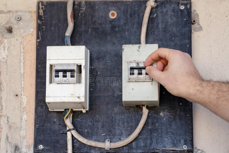 Electrician check or Inspect Electrical System circuit Breaker on Power Distribution panel royalty free stock image