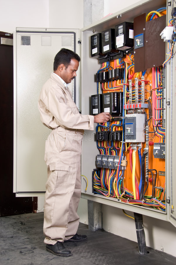 Electrician checking circuit stock photography