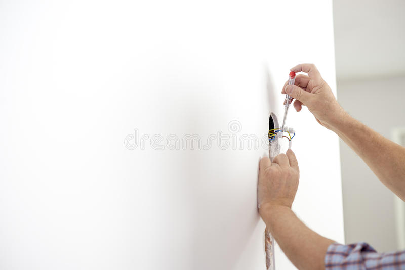 Electrician checking the presence of electrical current in a new royalty free stock photos