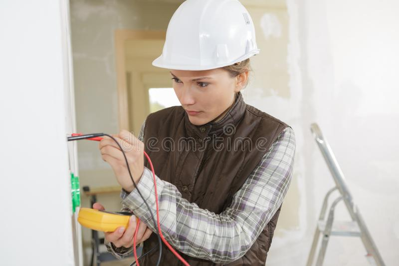 Electrician checking socket voltage royalty free stock images