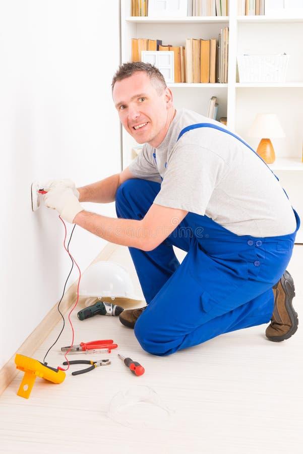 Electrician checking socket royalty free stock photos
